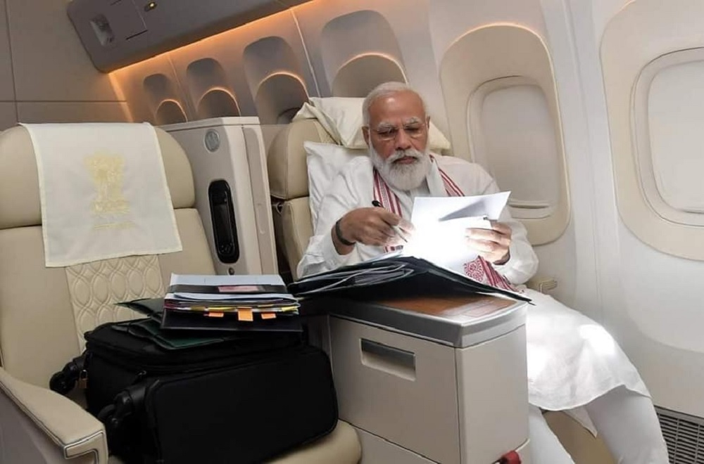 Narendra Modi :A long flight also means opportunities to go through papers and some file work.