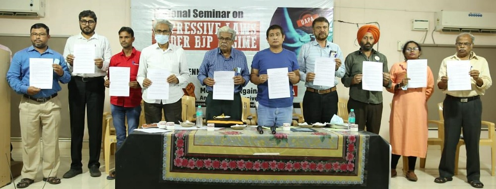 """Releasing report of """"Summary of Latest Data about UAPA Cases published by NCRB"""" during the seminar."""